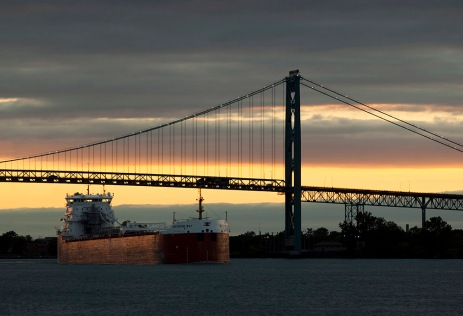 A freighter sails on the Detroit River, past the Ambassador Bridge.