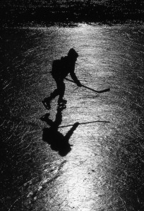 A BOY SKATES ON A FROZEN POND IN SOUTHERN ONTARIO.