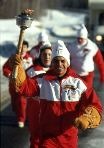 WEARING MOOSE HIDE MITTS, JIM CADA JR. CARRIES THE TORCH NEAR BLIND RIVER, ONT.