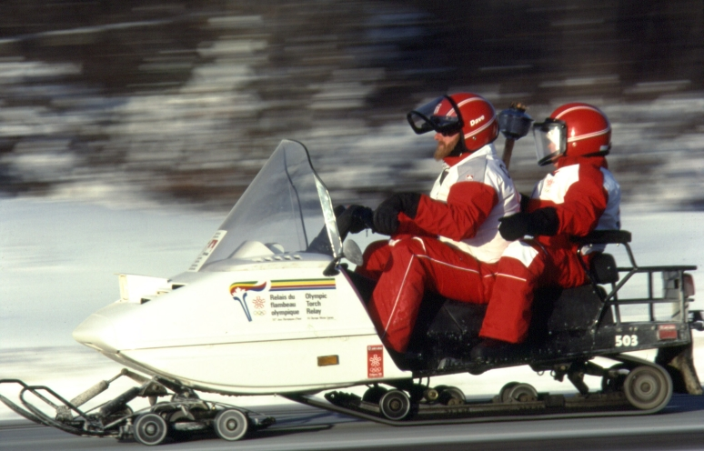 THE OLYMPIC TORCH TRAVELS VIA SNOWMOBILE NEAR SAULT STE MARIE, ONT., JANUARY 9, 1988.