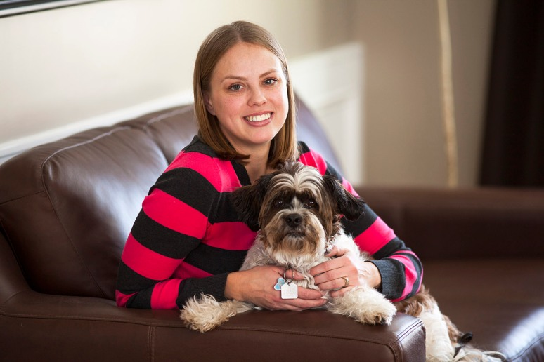 SANDRA RELAXES WITH HER DOG WHISKEY IN HER CALGARY HOME.