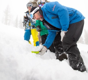 GUIDE DARREL LEWKO DEMONSTRATES AVALANCHE BEACON TECHNIQUE