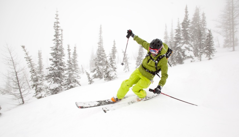 BRIAN MCKEEVER CARVES A TURN ON TELEMARK SKIS WITH POWER STAGECOACH CAT SKIING