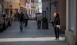 A WOMAN TAKES A SMOKE BREAK IN PASSAU, GERMANY