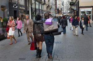 SHOPPERS CARRY BAGS FROM DESIGNER SHOPS IN VIENNA